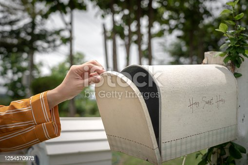 Senior latin american woman at home checking her mail - Lifestyles