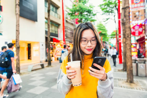 Checking mails and social media in Ximending stock photo