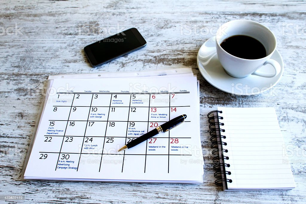 Checking monthly activities in the calendar royalty-free stock photo