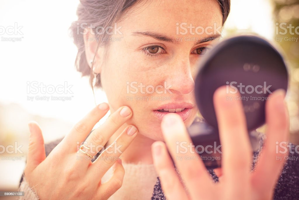 Checking my Look in Powder Compact Mirror stock photo