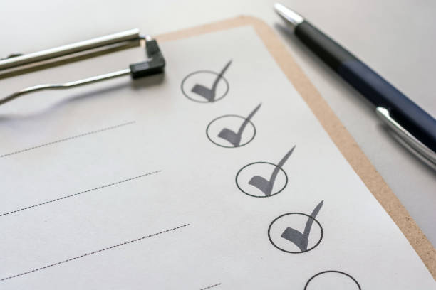 Checking off a checklist on a clipboard check list checklist stock pictures, royalty-free photos & images