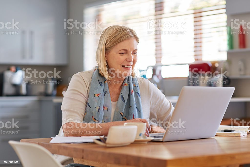 Checking on her finances stock photo