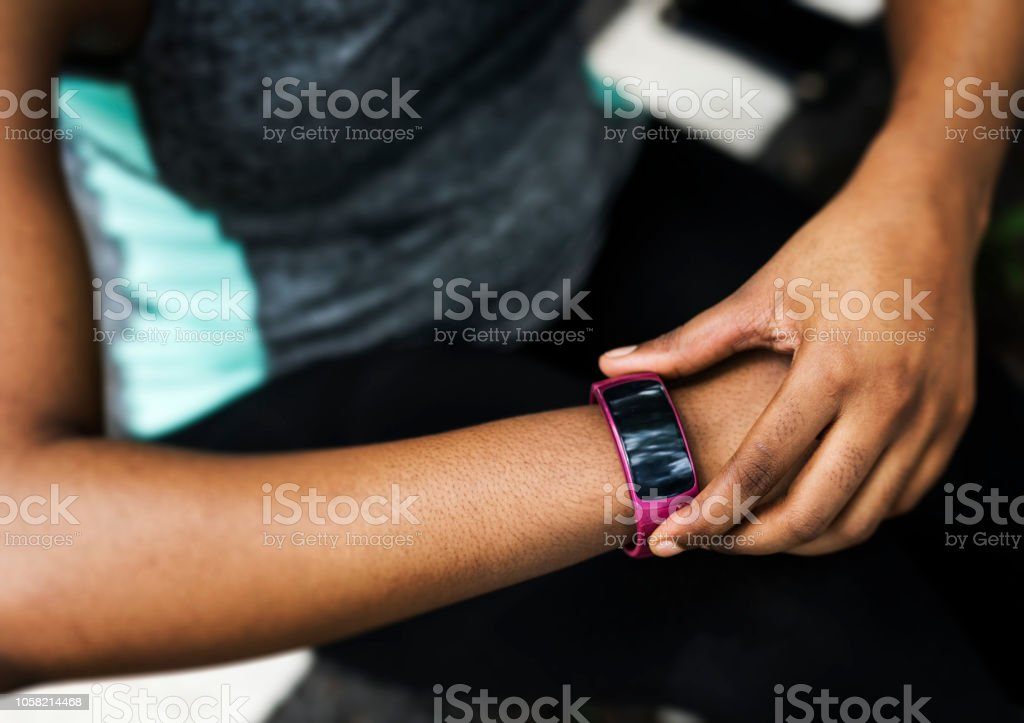 Checking on the smart watch stock photo