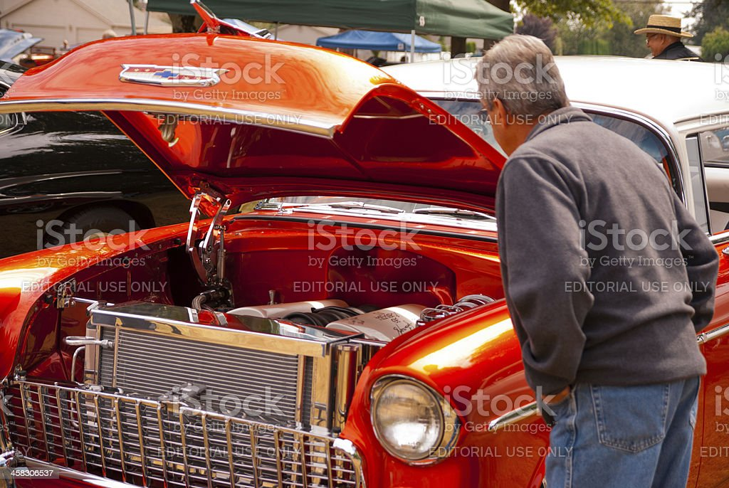 Checking Out a Classic Chevrolet stock photo