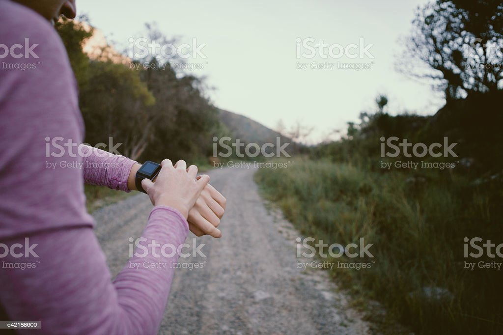 Checking out my fancy new smart running watch stock photo