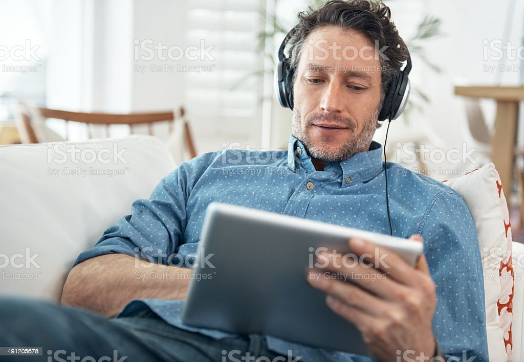 Checking out the latest tunes stock photo
