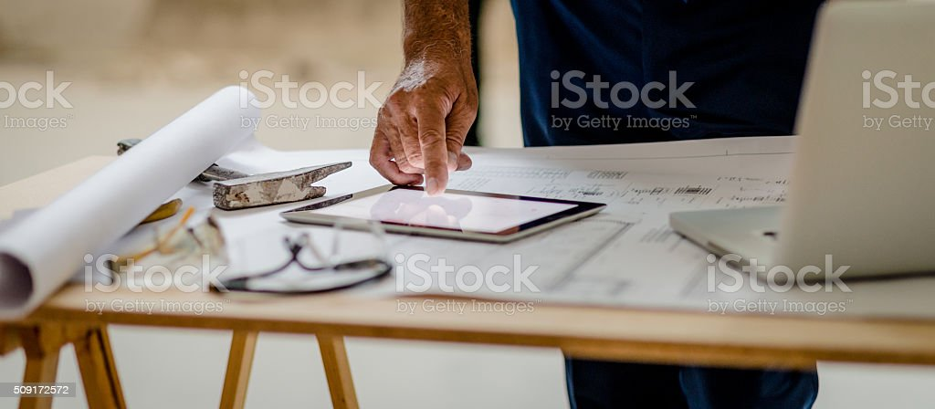 Checking plan on a digital tablet stock photo