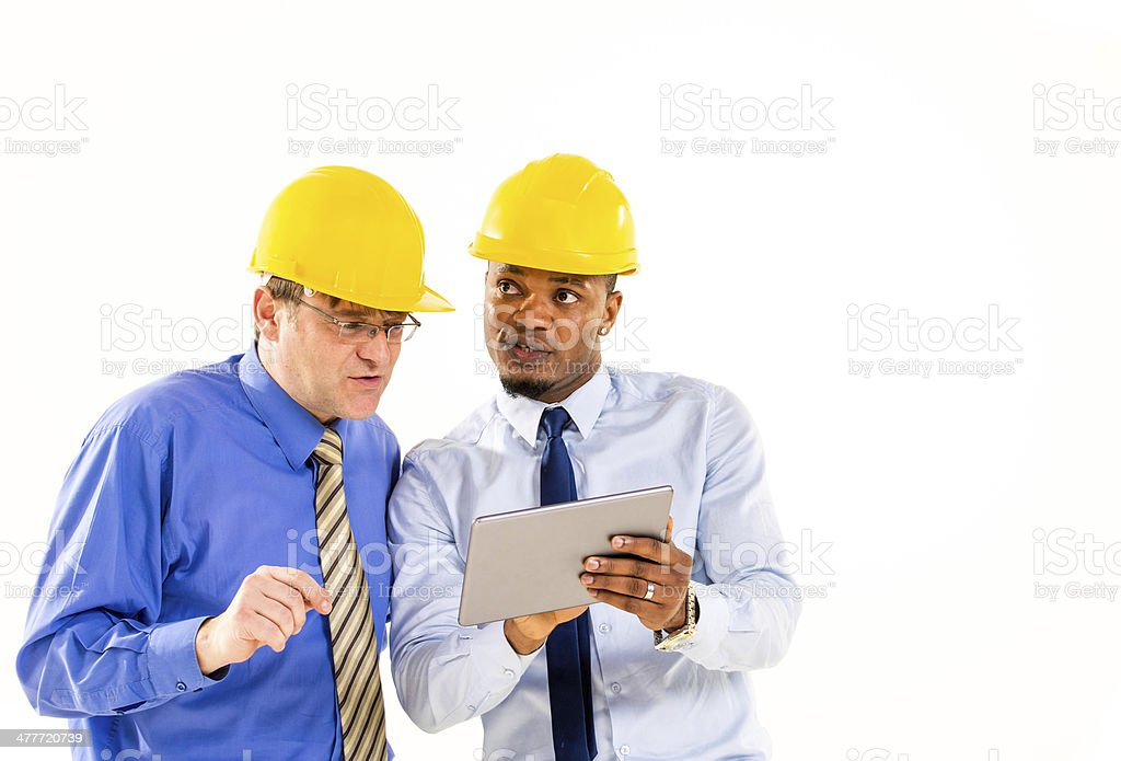 Checking plans on toucpad stock photo