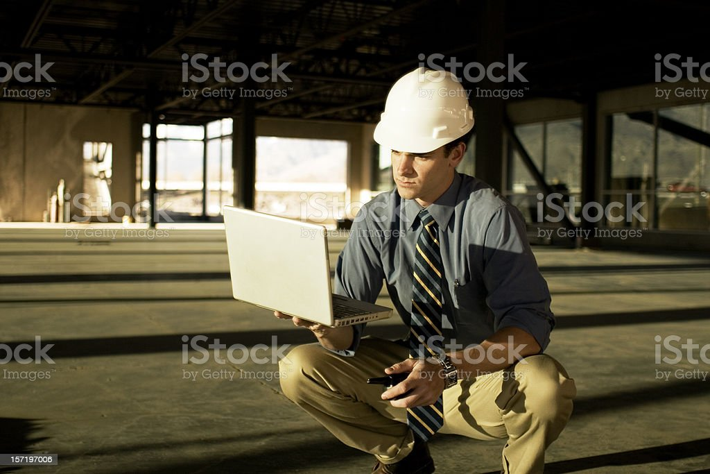 Checking Plans royalty-free stock photo