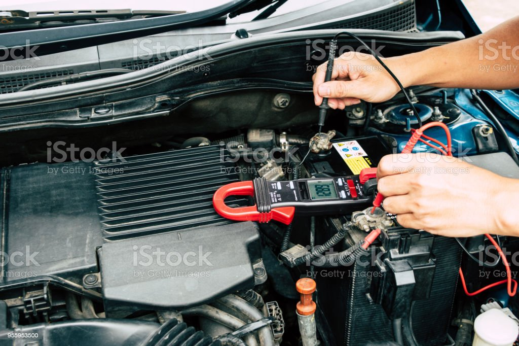 Checking power of battery by clamp meter, maintenance car by yoursalf, Monthly check. stock photo