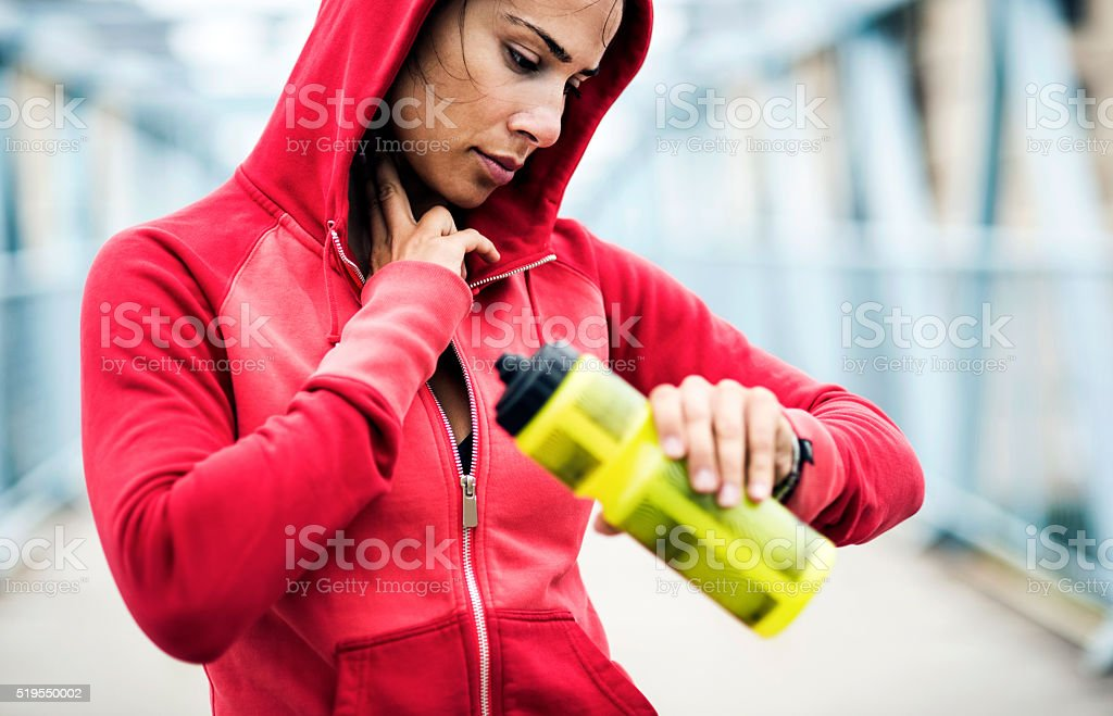 Checking pulse during exercise stock photo
