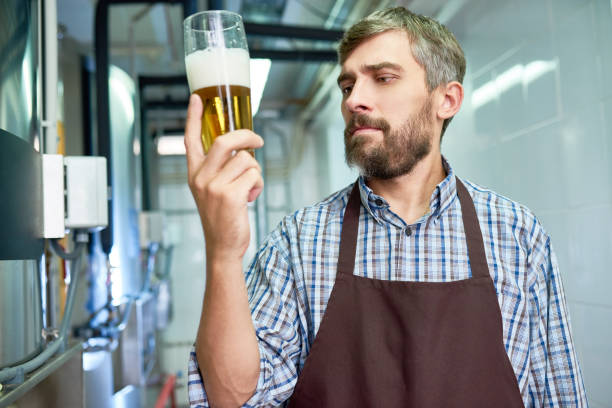 Checking Quality of Fresh Beer stock photo