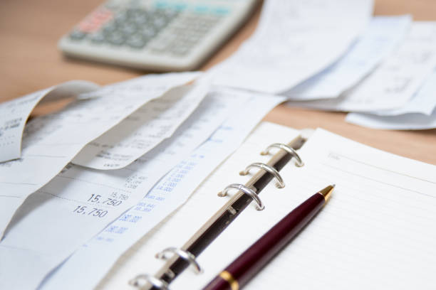 Checking receipt. Finance concept with receipts, calculators, and notes. Defocused. stock photo