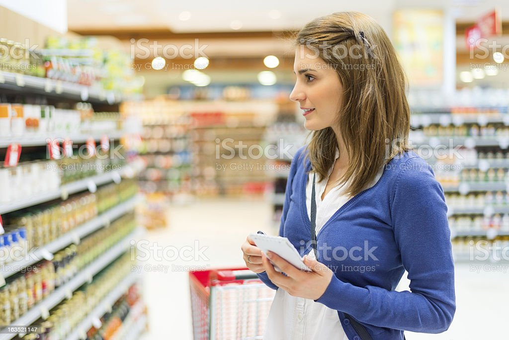 Checking shopping list stock photo