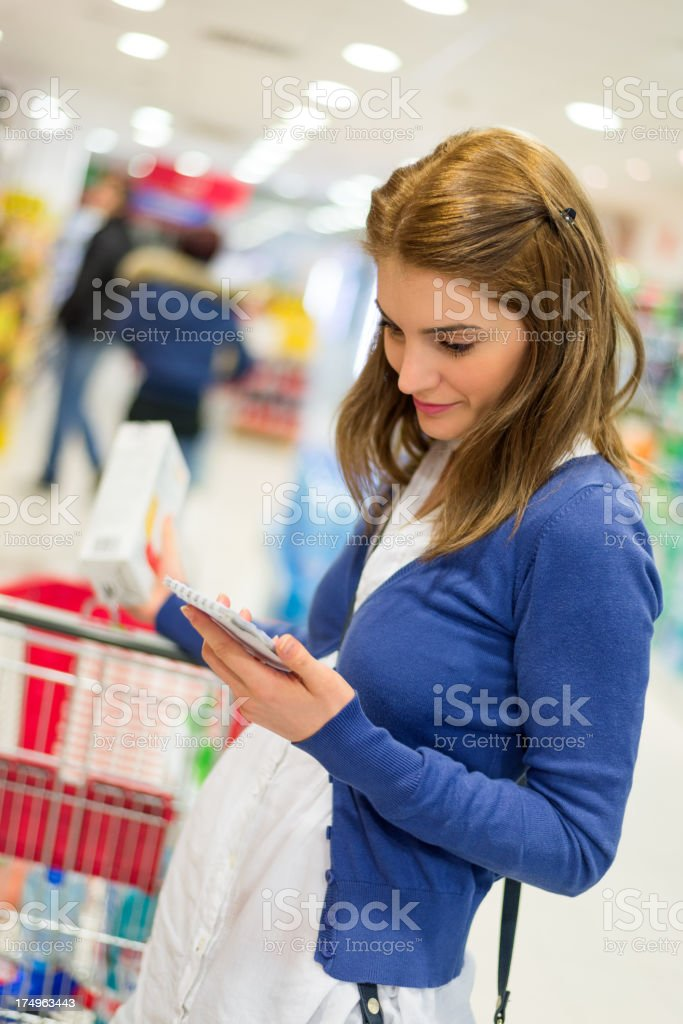 Checking shopping list royalty-free stock photo