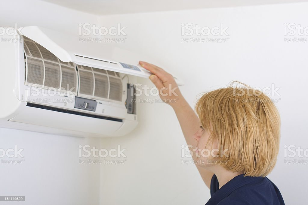 Checking state of air conditioner stock photo