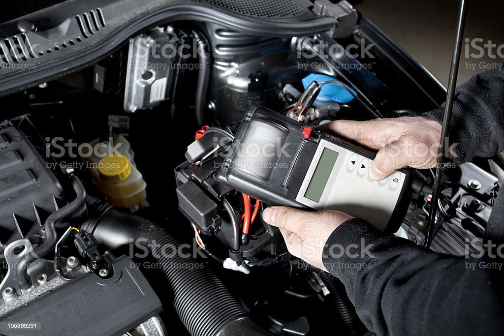 Checking the battery and electrical system of a car stock photo