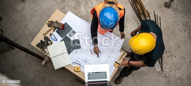 istock Checking the blueprints 812099500