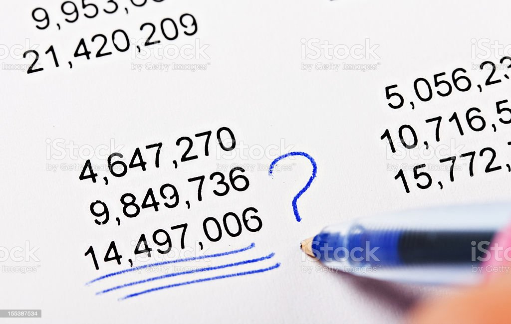 Checking the calculations: woman's hand queries  a figure on spreadsheet royalty-free stock photo