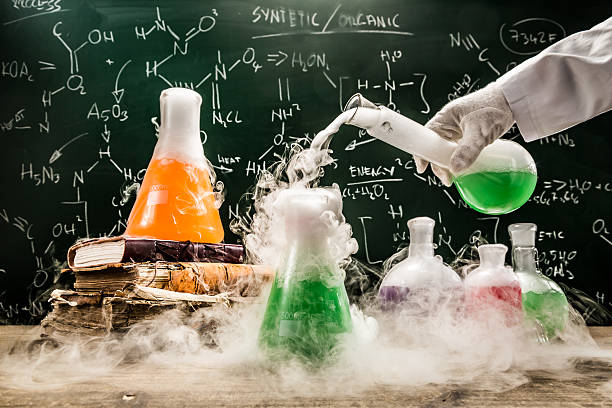 checking the chemical formula in academic laboratory - chemical stock photos and pictures