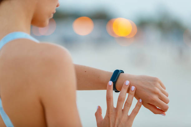 Checking the fitness tracker on her wrist stock photo