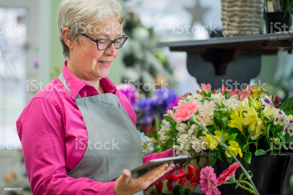 Checking the Flowers stock photo