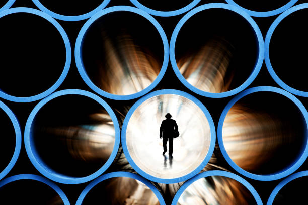 checking the inside of the pipe stock photo