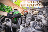 istock Checking the level of engine oil. 1264619042