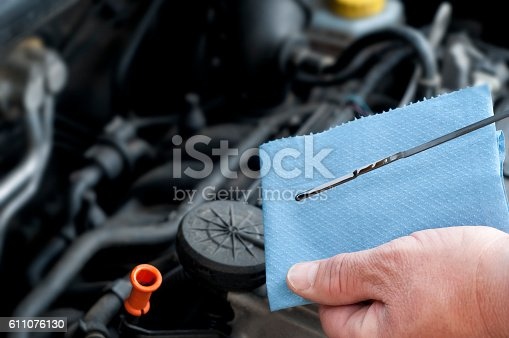 istock Checking the oil status of personal land vehicle. 611076130