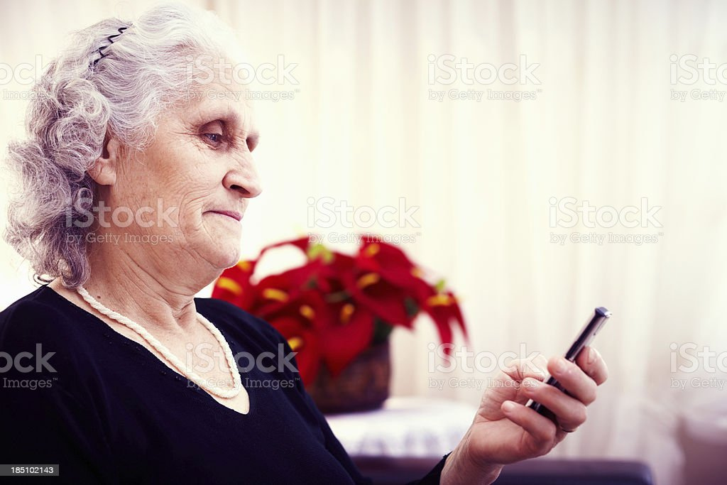 Checking the phone royalty-free stock photo