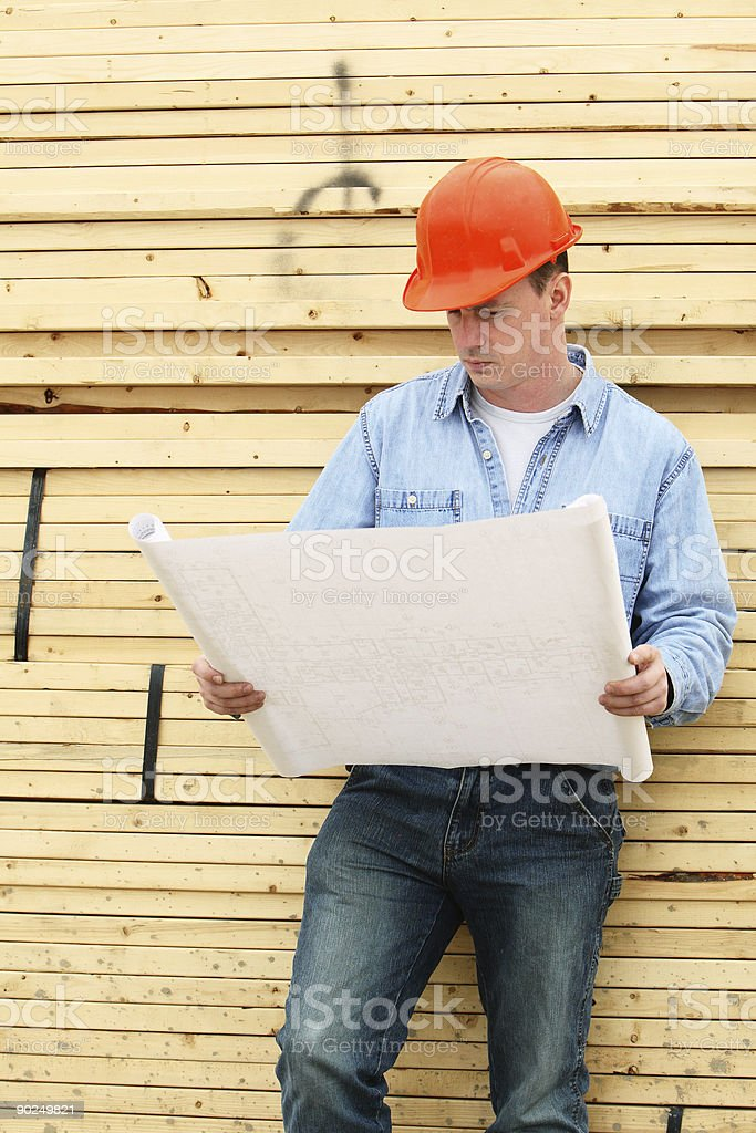 Checking The Plans. royalty-free stock photo