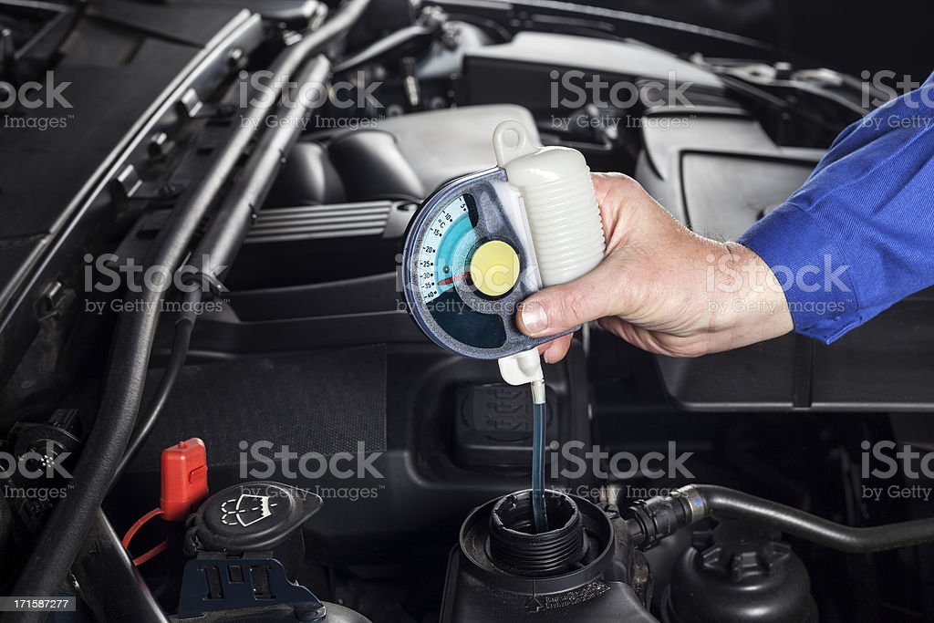 Checking the radiator antifreeze stock photo