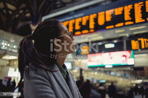 young woman checking the time table for transport