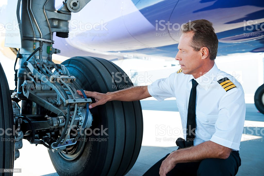 Checking the wheels. stock photo
