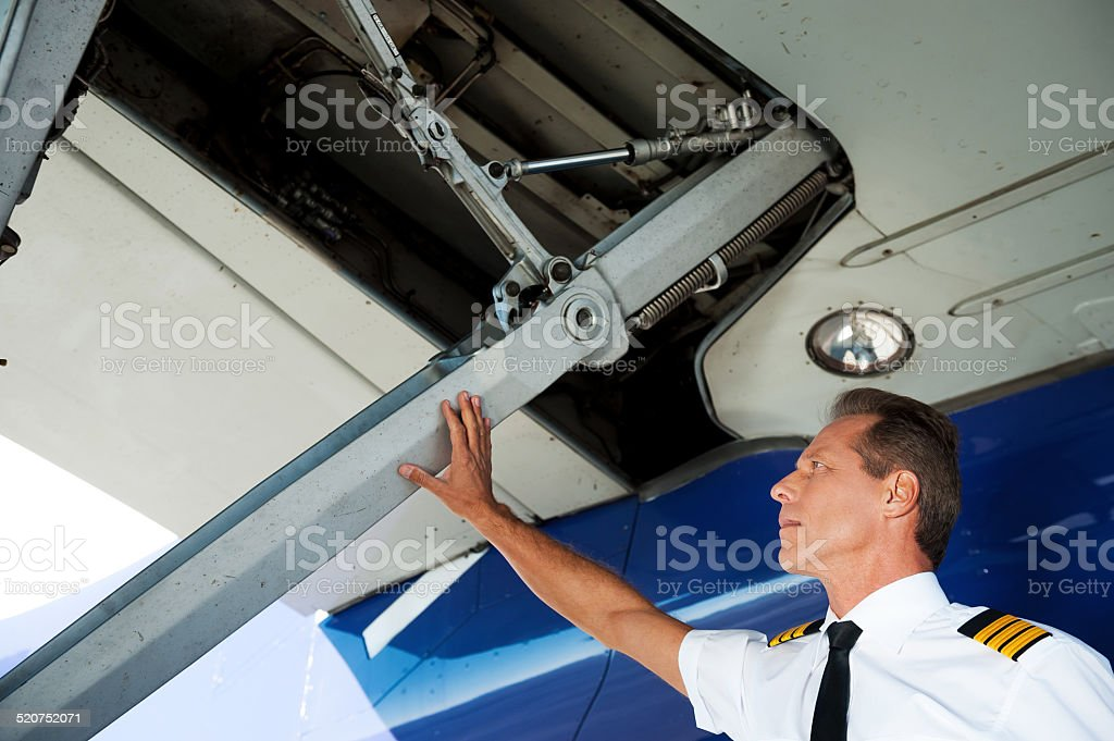 Checking the wing. stock photo