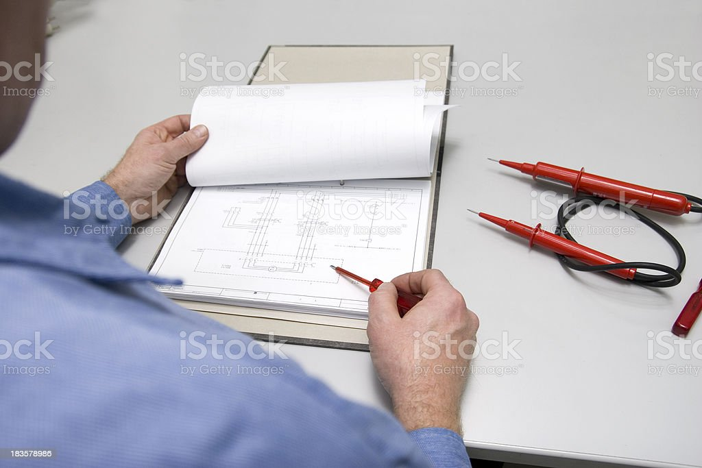 Checking the Wiring Diagram stock photo