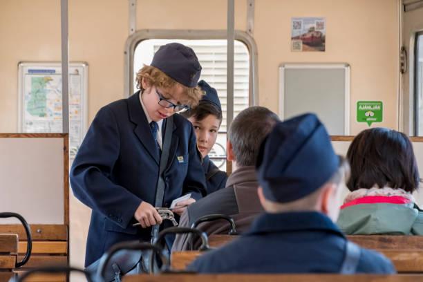 Checking tickets on Gyermekvasút train in Budapest stock photo