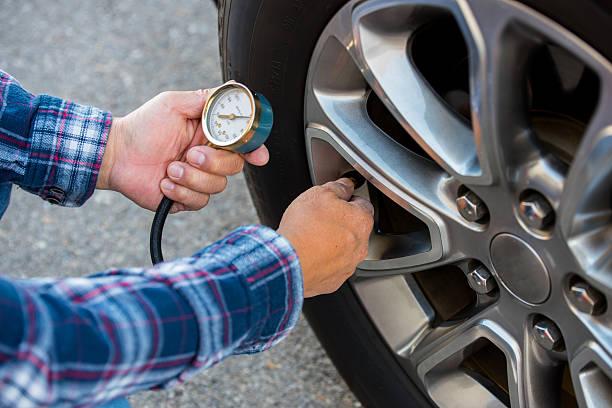 Checking Tire Pressure stock photo
