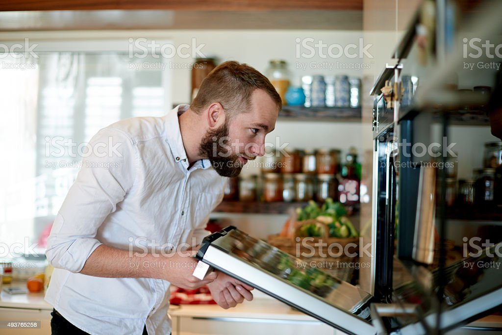 Checking to see if it's done stock photo