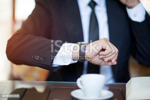 Businessman checking to time