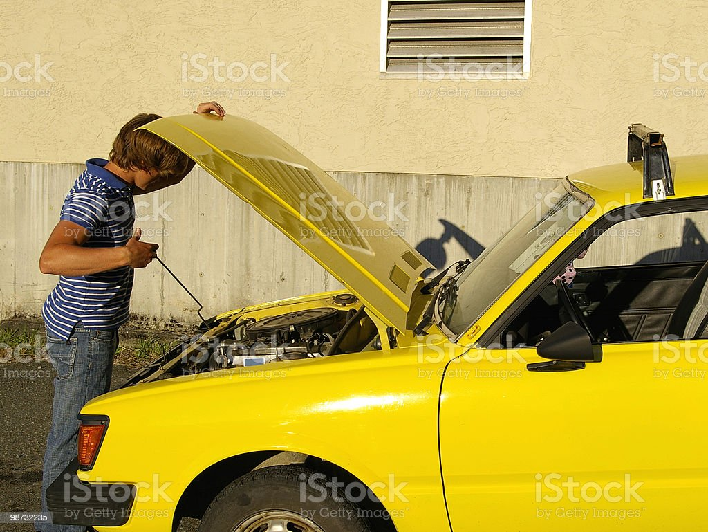 Checking under the Hood royalty-free stock photo