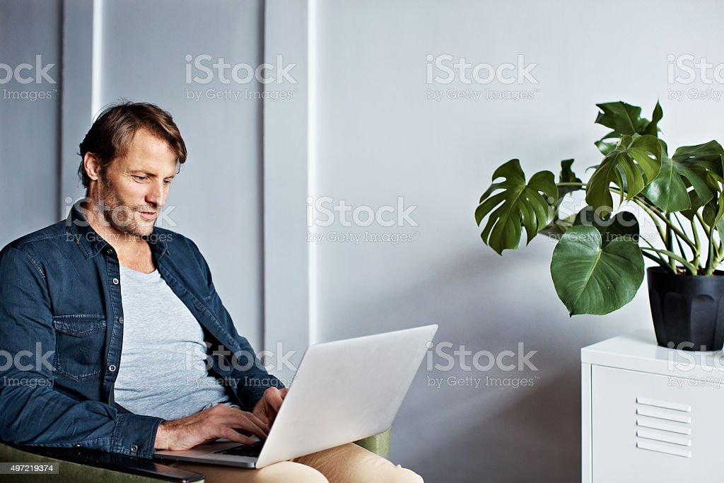 Checking up on his newsfeeds stock photo