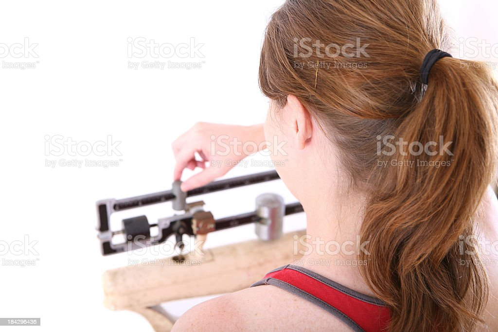 Checking Weight royalty-free stock photo