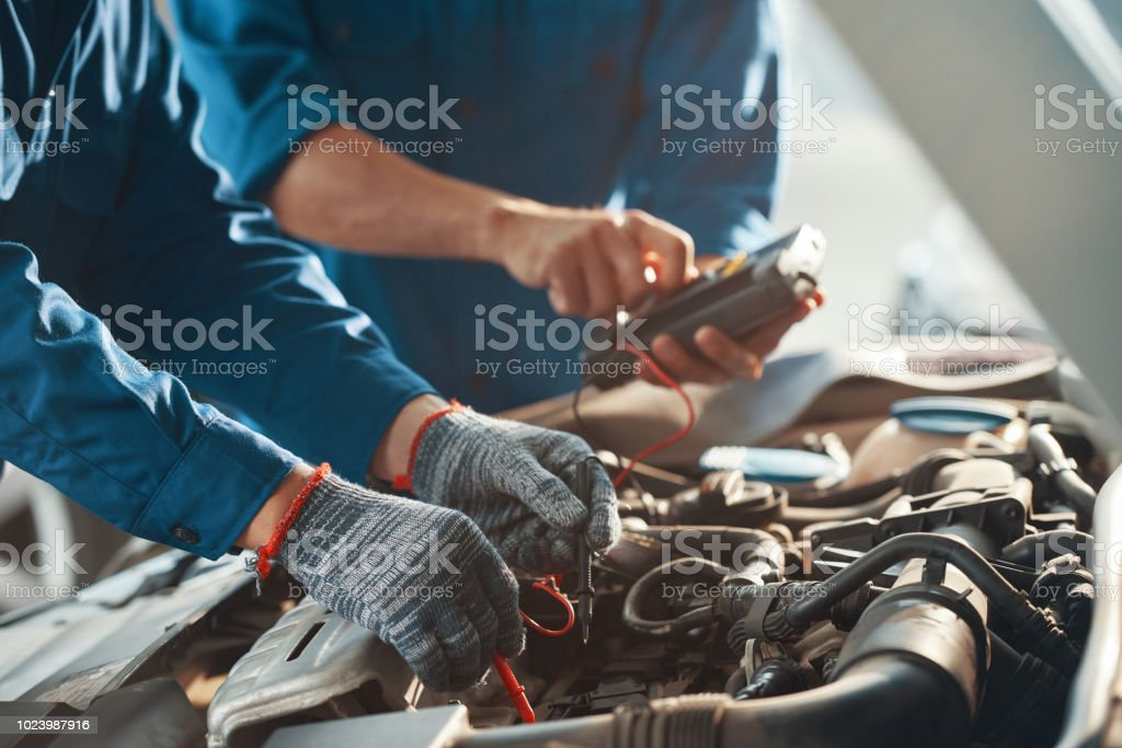 Checking work of car engine stock photo