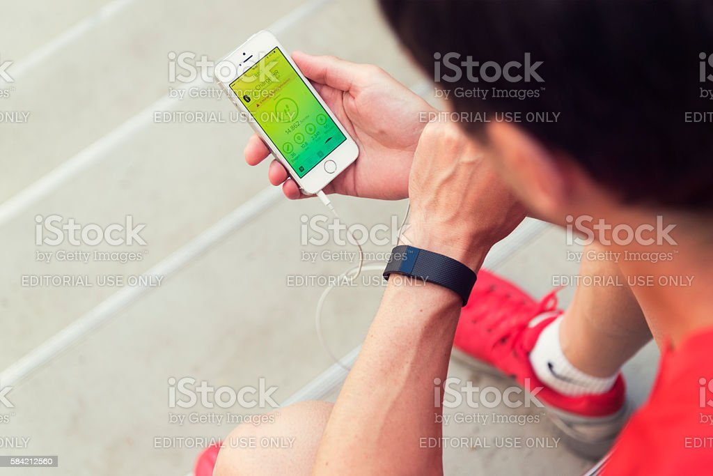 Checking your Fitbit-App in German stock photo