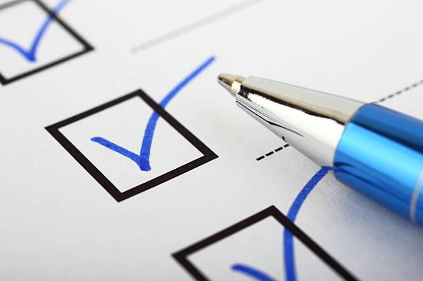 Checklist and pen stock photo