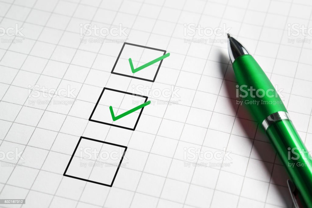 Checklist and to do list with v sign check marks in square box. Pen and paper. Project management, planning and keeping score of completed tasks concept. stock photo