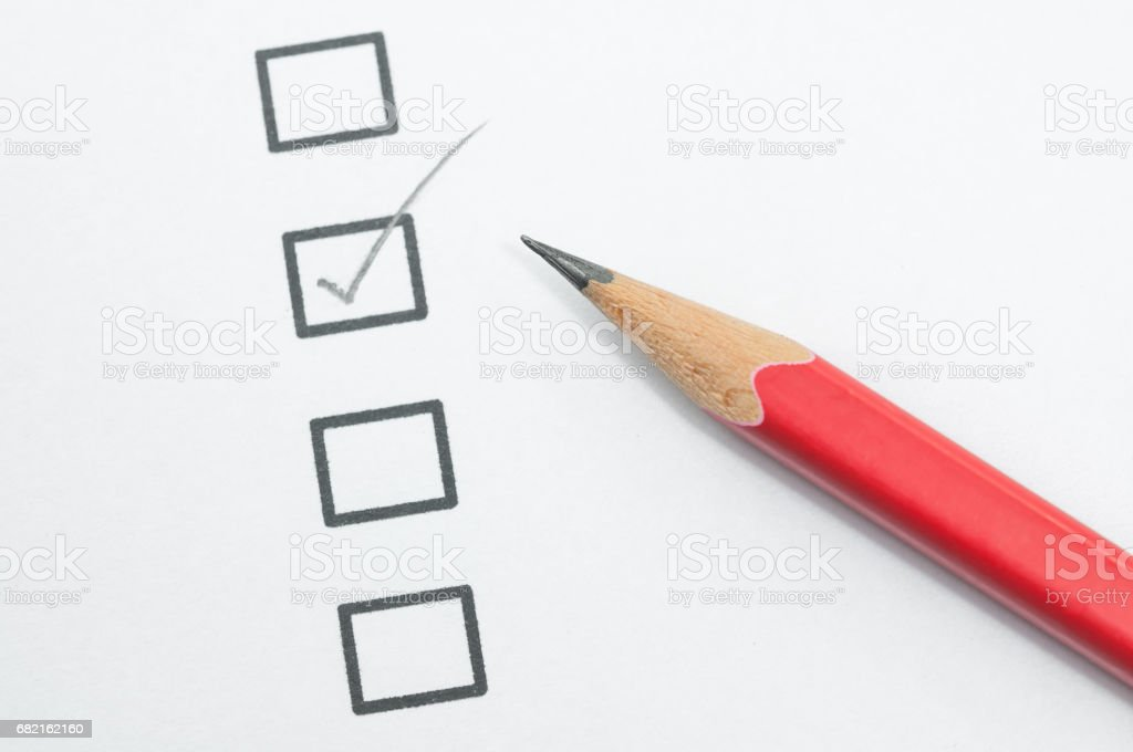 checklist box and red pencil on white paper. stock photo