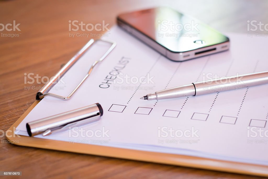 Checklist concept - checklist, paper and a pen stock photo