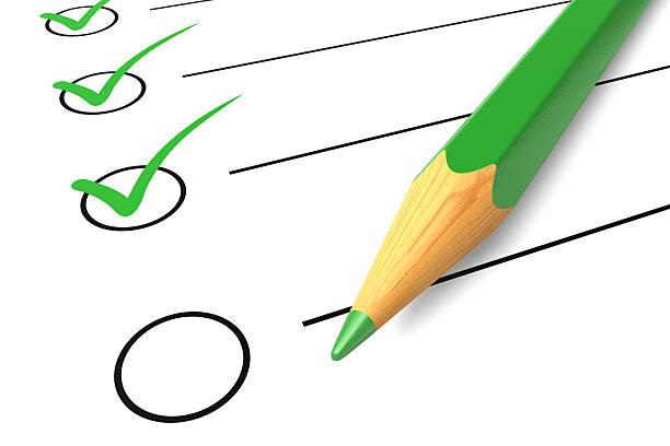 Checklist green pencil stock photo